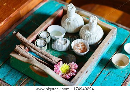 Spa massage tray treatment on old wooden background.