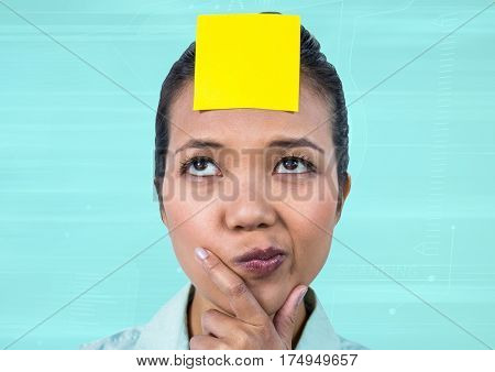 Frustrated businesswoman with sticky note stuck on her forehead against blue background