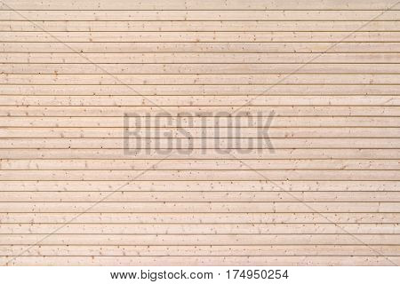 Wooden wall made of untreated, horizontal, screwed boards of spruce wood