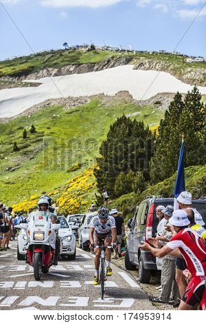 Col de PailheresFrance- July 06 2013: The French cyclist Samuel Dumoulin from Ag2r-La Mondiale Team climbing the road to Col de Pailheres in Pyrenees Mountains during the stage 8 of the 100 edition of Le Tour de France on 6 July 2013.