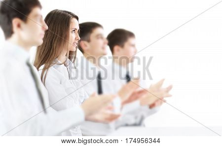 Happy business group applauding the company's success isolated on white background