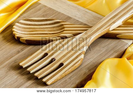 cutting board and utensils in bamboo wood