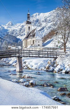 Panoramic View Of Scenic Winter Landscape In The Bavarian Alps With Famous Parish Church Of St. Seba