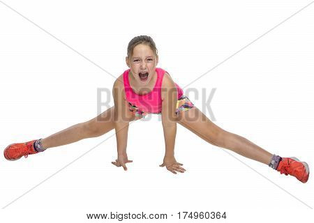 Young girl doing a painful stretching excercise on white background.