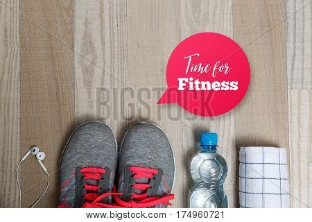 Fitness gym equipment. Sneakers, water bottle with towel. Time for fitness speech bubble. White headphones for music and sport. Workout footwear.