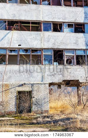 Broken Glass Window In The Old Abandoned Industrial Building. The Crisis, The Fall Of The Economy, T