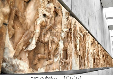 ATHENS GREECE - DECEMBER 30 2016: Section of west frieze from the Elgin Marbles of Parthenon in the Acropolis museum.