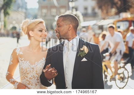 Happy African American Groom And Cute Bride Walking On Street