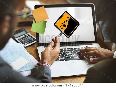 Business People Discussion Rockfall Beware Sign on Laptop