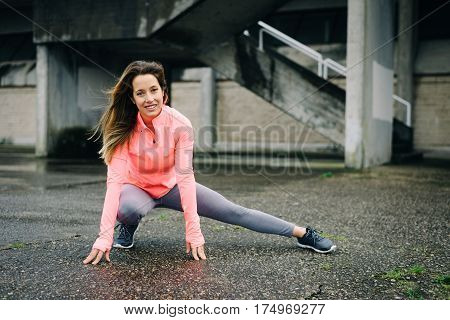 Sporty Woman On Urban Stretching Fitness Workout