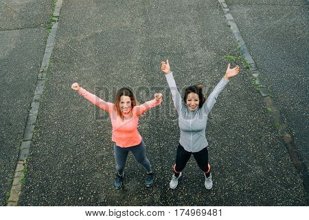 Two Successful Sporty Women Celebrating Fitness Workout Goals