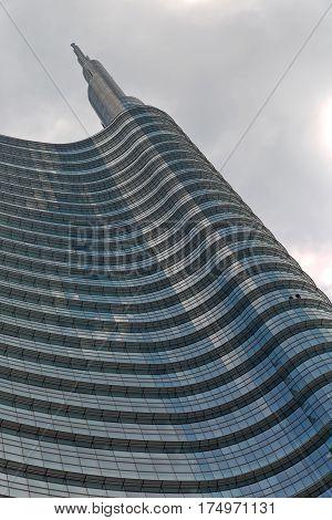 Architectural Facade detail of a modern high-rise apartment building blue tinted curtain wall facade