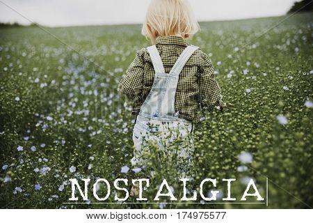 Nostalgia word on young boy outdoors