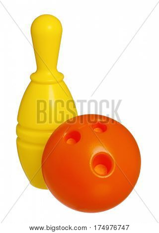 Single plastic skittle of toy bowling with orange ball isolated on a white background