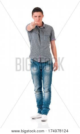 Teen boy pointing at camera choosing you, isolated on white background. Caucasian young man pointing finger to you.