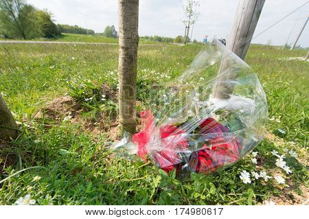 Memorial flowers near the road for somebody killed by traffic accident