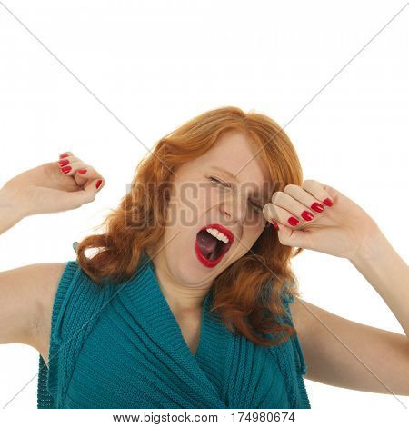 Portrait attractive woman yawning with red hair isolated over white background