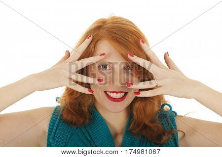 Portrait attractive woman with red hair hiding behind her hands isolated over white background