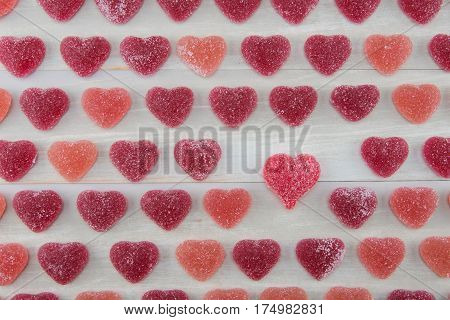 Small Dark Red and Pink Gummy Hearts with One Larger Read Gummy Heart standing out