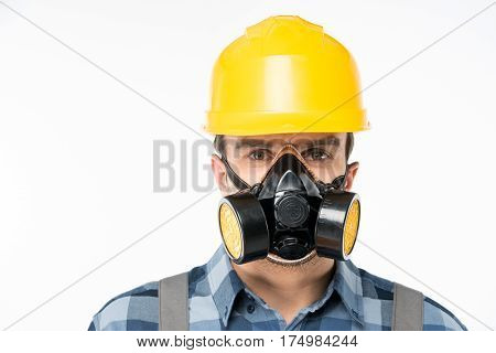 Close-up portrait of workman in protective workwear looking at camera