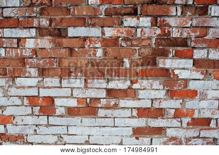 Old brick wall with white and red bricks