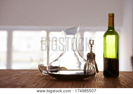 Glass carafe of wine on wooden table