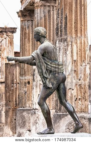 bronze of the god Apollo in the ancient city Pompeii destroyed by the eruption of Vesuvius in the year 79 BC. during the rule of Roman Emperor Vespasian