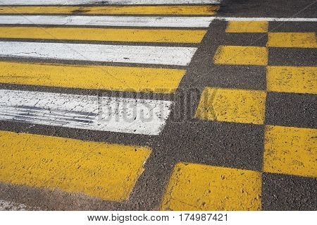 Crosswalk. White and yellow pedestrian crossing marking.