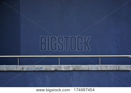 Blue wall and metal railing. Abstract architectural background.