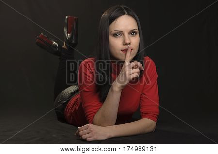 Girl With Red Make-up On A Black Background