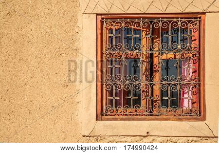 Rammed Earth Wall With Traditional Wrought Iron Window