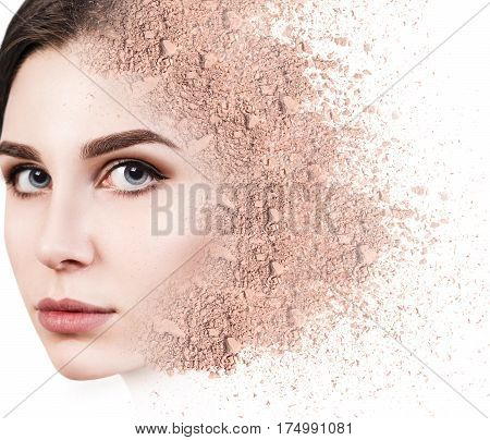 Young woman face made from crumbly powder isolated on white background