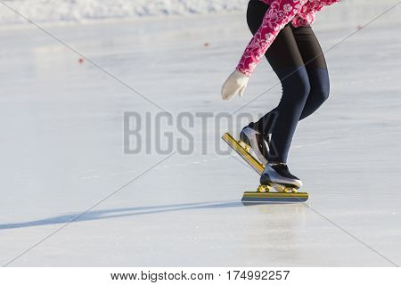 Winter sport concept - golden Ice skates , telephoto close up