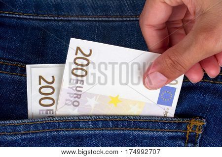 Hand Holding Euro Banknotes