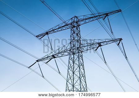 Electricity Pylon Over Blue Sky