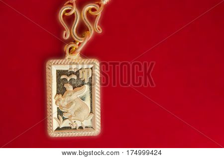 Rabbit Gold Frame Pendant 90K Percent Thai Gold Grade Isolated On Red Background