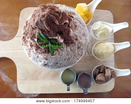 Bingsu Dessert (korea Finely Ground Milky Ice) Flavored With Chocolate Powder And Fruit Topping