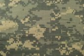 Universal camouflage pattern army combat uniform digital camo USA military ACU macro closeup detailed large rip-stop fabric texture background crumpled wrinkled foliage green yellow desert sand tan urban gray  poster