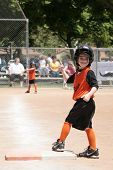 Young Child in Softball Game With Thumbs Up! poster