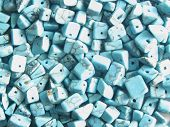 Turquoise beads used for crafts. poster