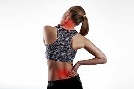 Fit girl having back and neck pain. Concept of spine therapy and health care.
