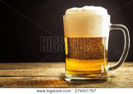 Glass Of Beer On A Black Background. Sales Of Alcohol. Beer In A Glass. Czech Beer.
