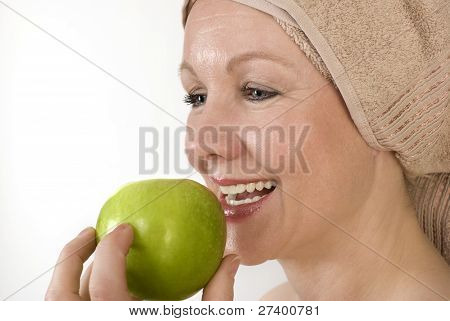 Adult Woman Biting An Apple.