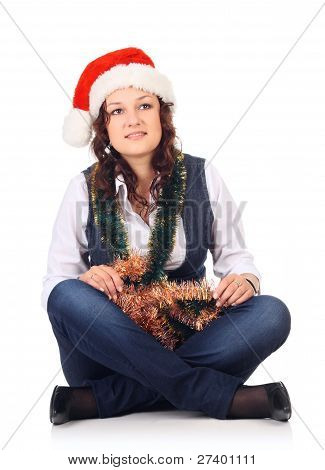 Girl In A Santa Hat With Christmas Decoration