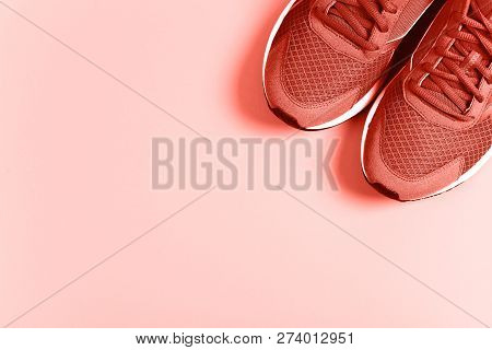Coral Sneakers Onpastel Background. Concept Of Healthy Lifestyle And Food, Everyday Training And For
