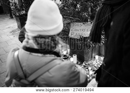 Strasbourg, France - Dec 13, 2018: People Looking At All United Against Barbarism Message On Rue Des