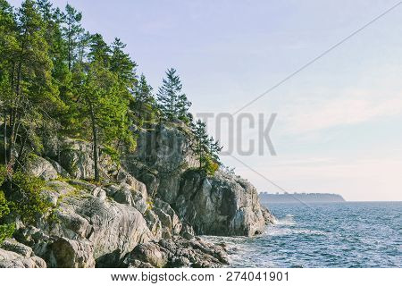 View Of Vancouver Over The Burrard Inlet Ocean From Lighthouse Park In West Vancouver On North Shore