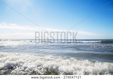 Soft Wave Of Blue Ocean On Sandy Beach
