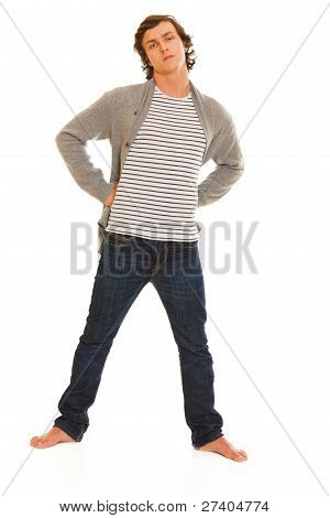 Full Length Portrait Of Young Man In Jeans And Sweater On White Background