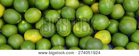 green fresh lemon lime texture background / pile of lime lemon for sale in the market
